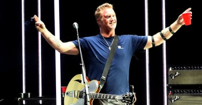 QOTSA's Josh Homme issues apology after kicking photographer in the head