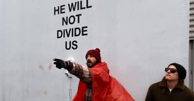 """The """"He Will Not Divide Us"""" Art Piece Has Moved To A Mystery Location"""