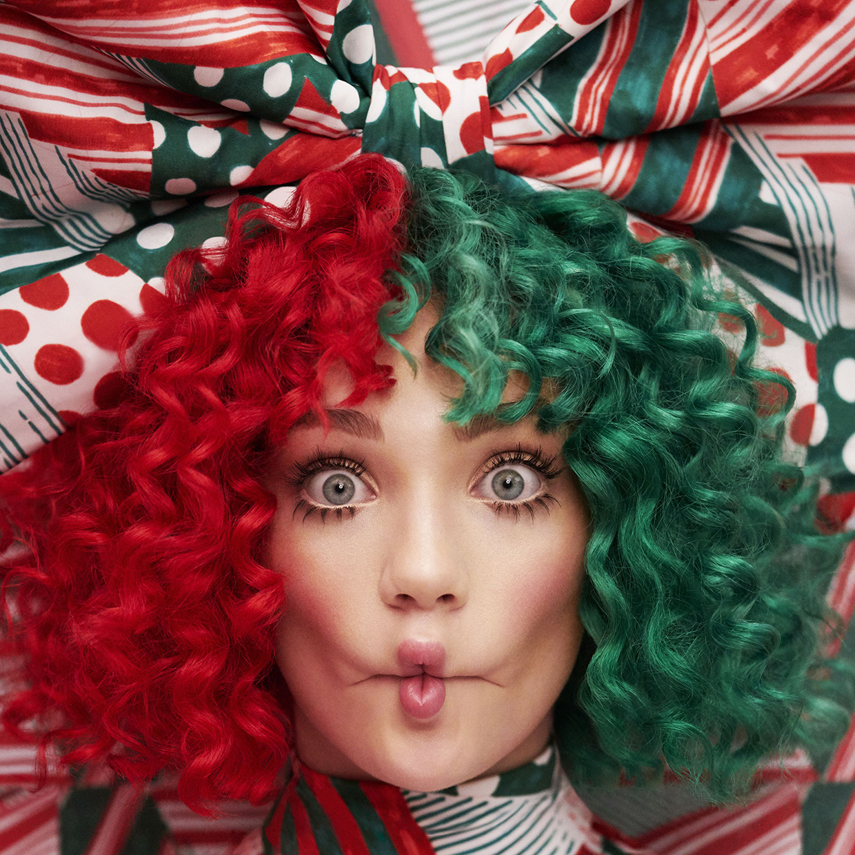 Thank God Sia is doing Christmas music her way