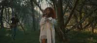 "Watch SZA perform an enchanting rendition of ""Go Gina"" in the forest"