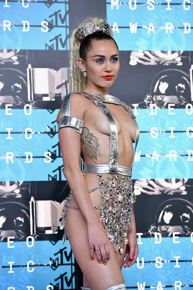 Here's Every Outfit Miley Cyrus Wore While Hosting The VMAs