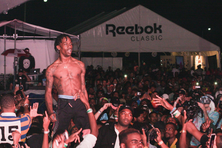 Travi$ Scott's Lollapalooza Set Shut Down After Audience Crashes Stage