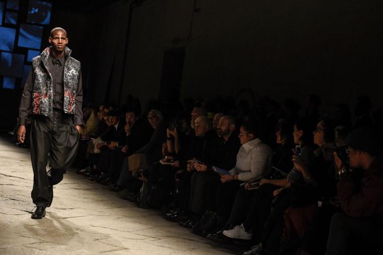 African Models Seeking Asylum In Europe Walk At Pitti Uomo