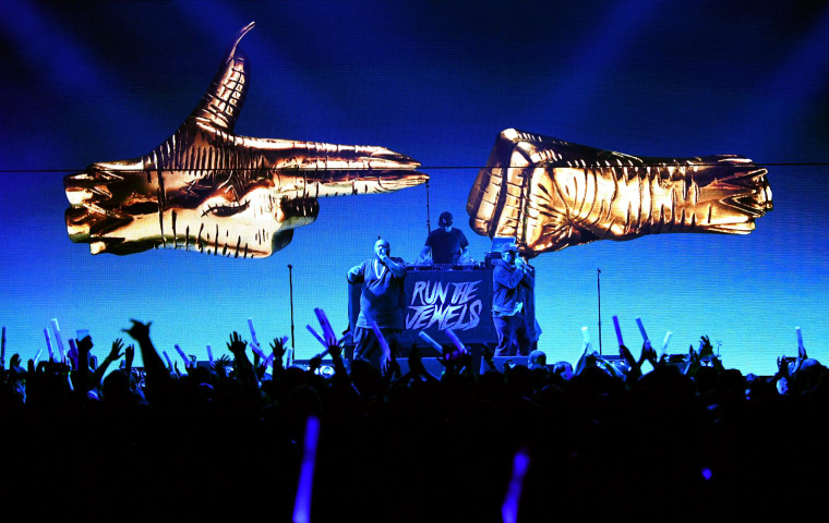 """Run The Jewels reveal countdown clock and """"emergency tip line"""" number"""