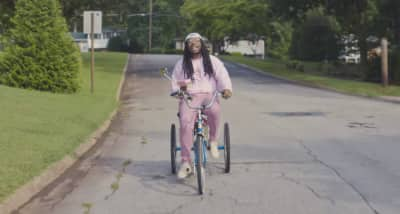 "Bike Around The Neighborhood With D.R.A.M. In His ""Cash Machine"" Video"