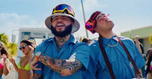 "Farruko and Bad Bunny play weed postmen in their ""La Cartera"" video"