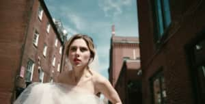 "Wolf Alice's Ellie Rowsell is a bride on the run in the band's new ""Space & Time"" video"