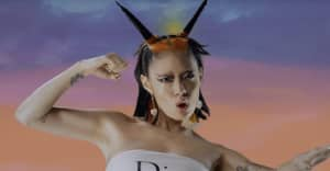 "Rina Sawayama goes high fashion for the ""Comme Des Garçons (Like the Boys)"" video"