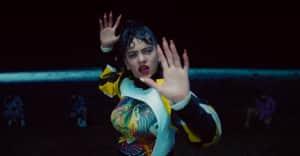 """Watch Rosalía's fiery """"De Aquí No Sales"""" video"""