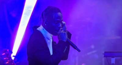 Travis Scott performs with James Blake and Earth Wind & Fire's Philip Bailey at the 61st Grammys