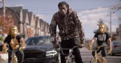"Raz Fresco And Tre Mission Stage A Surreal Crime Scene In The ""Swervin' In Bape"" Video"