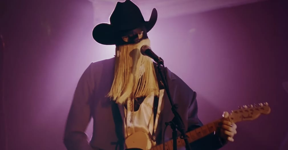 """Orville Peck's """"Turn To Hate"""" video is a mechanical bull-riding contest featuring Mac DeMarco"""