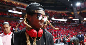 Lil Wayne hit with federal weapons charge for boarding a plane with a gold-plated handgun