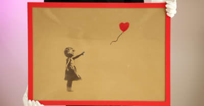 Banksy painting shreds itself minutes after being sold for $1.4 million