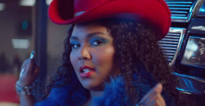 "Lizzo and Missy Elliott party in a parking lot in the ""Tempo"" video"