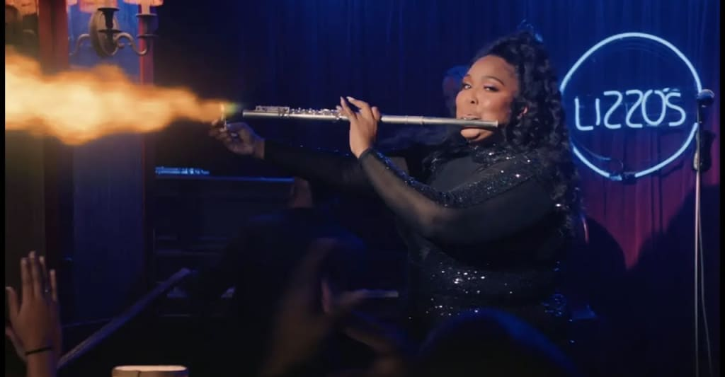 watch lizzo recreate the jazz flute scene from anchorman