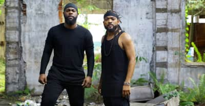 "Machel Montano And Bunji Garlin Are Stick Fighting Gurus In The ""Buss Head"" Video"