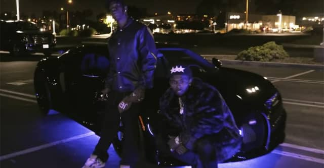 "Travis Scott, Pop Smoke share ""Gatti"" video 1"