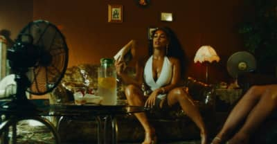 "Jorja Smith and Burna Boy channel summer energy in their ""Be Honest"" video"