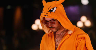 "Watch Bad Bunny, dressed in a Charizard onesie, perform ""Pero Ya No"" on Corden"
