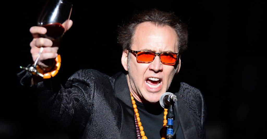 "Here's a clip of Nicolas Cage scream-singing ""Purple Rain"" at karaoke"