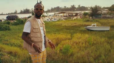 "Watch Popcaan's ""Dun Rich"" video featuring Davido"