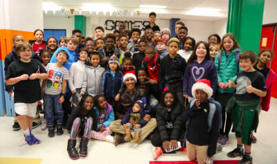 Watch Barack Obama deliver gifts to a room full of children