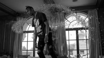 "Travis Scott levitates in his new, Jonah Hill-directed ""Wake Up"" video"