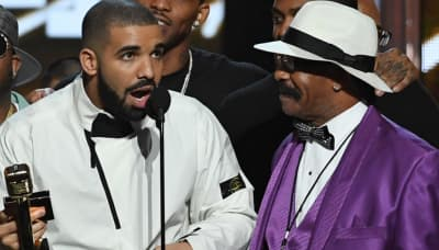 Drake plays up the absentee father schtick to sell records, according to his father