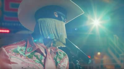 """Watch Orville Peck's glitzy new video for """"Queen of the Rodeo"""""""