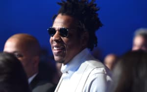 Jay-Z explains why he and Beyoncé remained seated during national anthem at Super Bowl