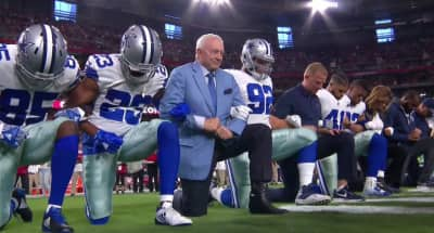 Dallas Cowboys owner and players take a knee before national anthem