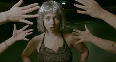 "Angel Olsen Conquers The Rock 'N Roller Disco In Her ""Shut Up Kiss Me"" Video"