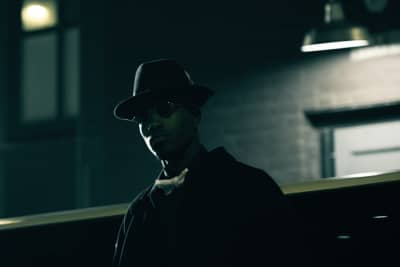 "Chris Cartier Stays Focused In The Noir-Like ""God First"" Video"