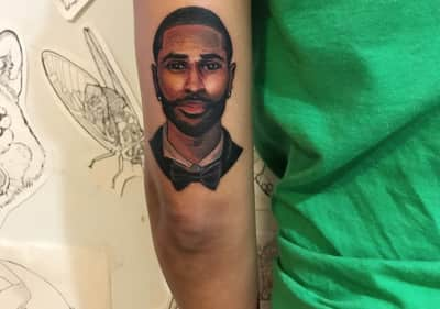 Jhene Aiko tattoos detailed image of Big Sean on her arm