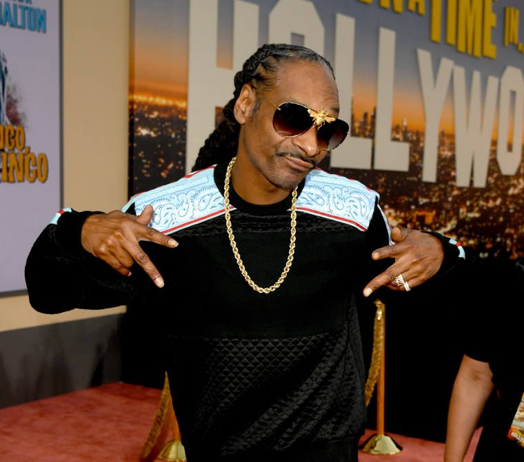 University of Kansas apologises after Snoop Dogg brings pole dancers to campus performance
