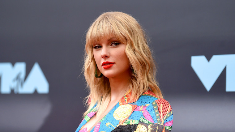 "Listen to Taylor Swift's cover of Phil Collins' ""Can't Stop Loving You"""