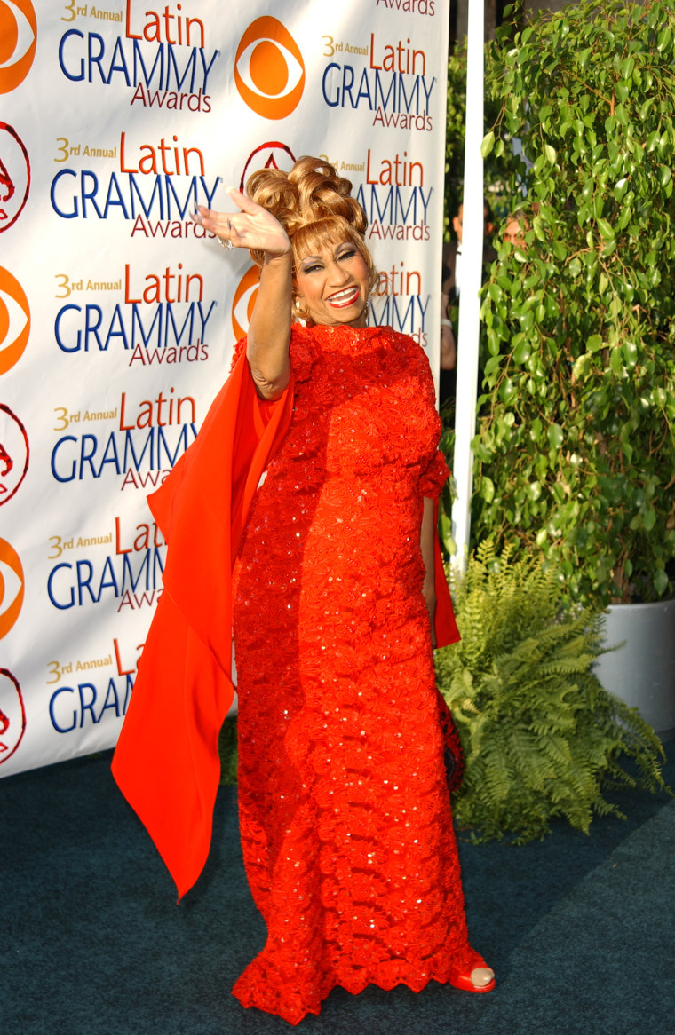 Cardi B is taking style notes from Celia Cruz and I'm here for it