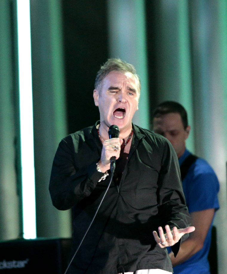 "Morrissey says a protester at a recent show was ""paid for and planted in the crowd by the British press"""