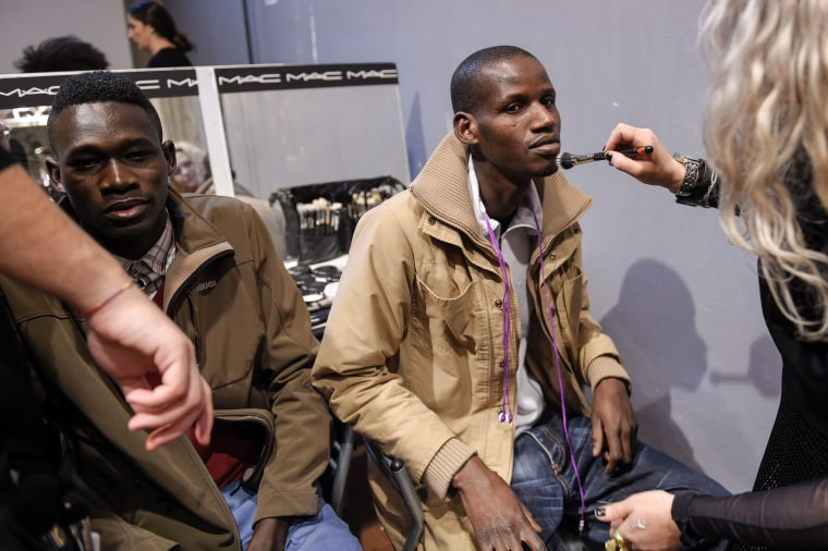 African Models Seeking Asylum In Europe Walk At Pitti Uomo