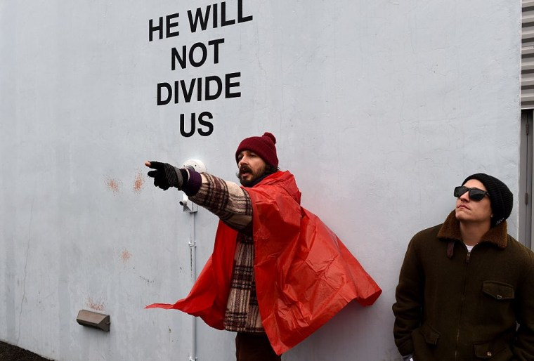 "The ""He Will Not Divide Us"" Art Piece Has Moved To A Mystery Location"
