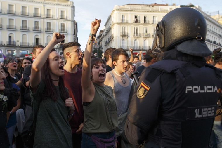 Riot police clash with referendum voters in Catalonia, leaving nearly 900 injured