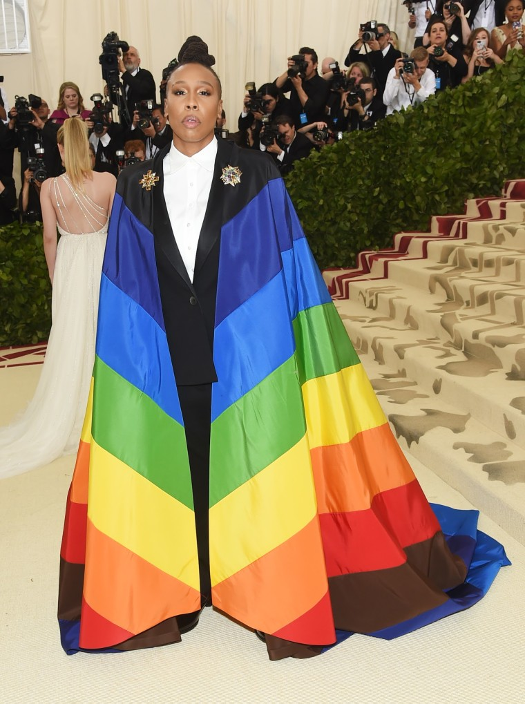 Lena Waithe goes bold with a rainbow cape at the Met Gala.