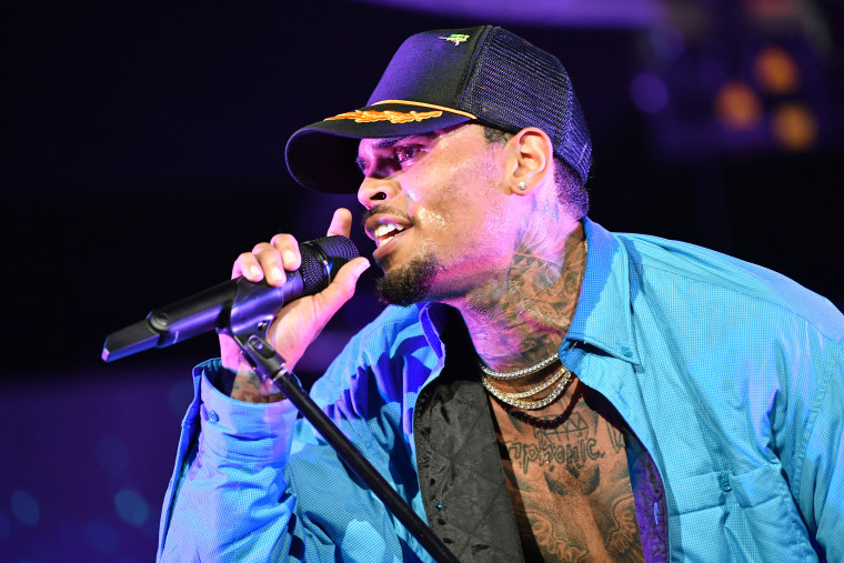 A felony battery charge against Chris Brown has been dropped