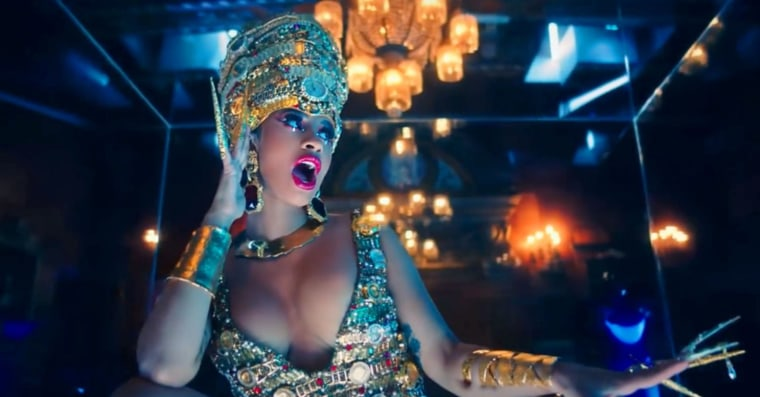 "Cardi B's ""Money"" video is full of iconic fashion history"