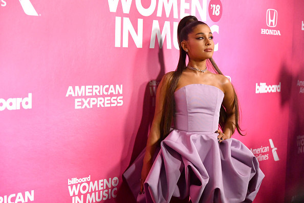 Ariana Grande trades her signature ponytail for her natural curls
